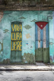 Viva Cuba Libre. A patriotic writing and a door painted with the cuban flag, Havana, Cuba stock images