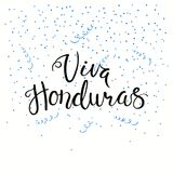 Viva Honduras Honduras lettering quote. Hand written calligraphic Spanish lettering quote Viva Honduras with falling confetti in flag colors. Isolated objects Royalty Free Stock Photos