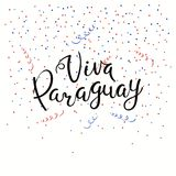 Viva Paraguay lettering quote. Hand written calligraphic Spanish lettering quote Viva Paraguay with falling confetti in flag colors. Isolated objects. Vector Stock Photos
