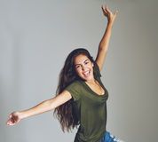 Vivacious attractive young woman celebrating Royalty Free Stock Photo