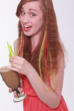 Vivacious beautiful teenager enjoying a party. Vivacious beautiful young teenager enjoying a party laughing at the camera while holding a cocktail in her hands Stock Images