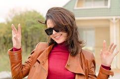 Vivacious beautiful woman outside a house Stock Photography