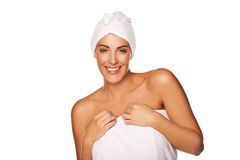 Vivacious beautiful woman in a towel. Vivacious beautiful woman wrapped in a towel around her body and head in a vitality, health and hygiene concept isolated on Stock Images