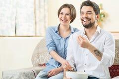 Vivacious couple watching TV Stock Photos