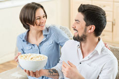 Vivacious couple watching TV Royalty Free Stock Images
