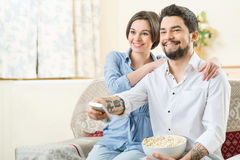 Vivacious couple watching TV Stock Images