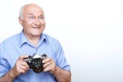 Vivacious grandfather holding camera Royalty Free Stock Photography