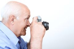Vivacious grandfather holding camera Stock Photography