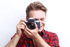 Vivacious guy holding camera Royalty Free Stock Image
