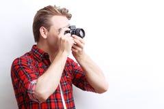 Vivacious guy holding camera Royalty Free Stock Photos