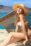 Vivacious happy woman in bikini on hammock Stock Image