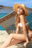 Vivacious happy woman in bikini on hammock Stock Image