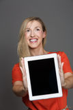Vivacious joyful woman with a tablet computer Royalty Free Stock Photos