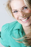 Vivacious laughing blond woman. Closeup natural facial portrait of a vivacious laughing blond woman with twinkling eyes Royalty Free Stock Photo