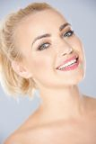 Vivacious laughing young blond woman Royalty Free Stock Image