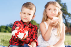 Vivacious little boy and girl eating marshmallow Royalty Free Stock Photography