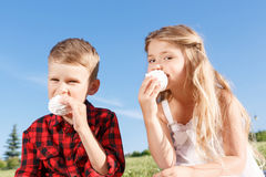 Vivacious little boy and girl eating marshmallow Royalty Free Stock Image