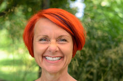 Vivacious middle-aged redhead woman Royalty Free Stock Images