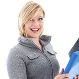 Vivacious office worker. Vivacious young blonde office worker with a lovely broad smile and animated look holding a file isolated on white Royalty Free Stock Images