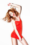 Vivacious Redhead Singing And Dancing Royalty Free Stock Photo