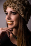 Vivacious smiling winter fashion model Royalty Free Stock Images