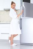 Vivacious woman in bathrobe and slippers Stock Image