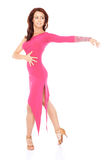 Vivacious woman dancing in a sexy pink dress Royalty Free Stock Images