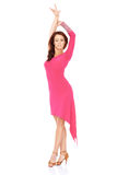 Vivacious woman dancing in a sexy pink dress Stock Image
