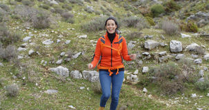 Vivacious woman enjoying a mountain hike Royalty Free Stock Photo