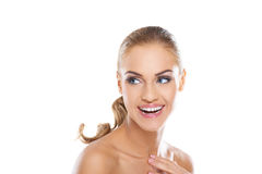Vivacious woman full of vitality. Beautiful young vivacious blonde woman full of vitality laughing a she glances back over her shoulder, head and shoulders Royalty Free Stock Images