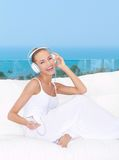 Vivacious woman listening to music Royalty Free Stock Photography