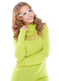 Vivacious woman in modern glasses. Vivacious beautiful woman with curly long blonde hair wearing modern white framed glasses and a warm winter jumper isolated on Stock Photo
