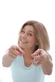 Vivacious woman pointing at the camera Stock Photos