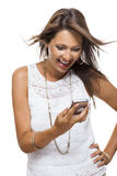 Vivacious woman reacting to a text message Stock Images