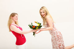 Vivacious woman receiving floral gift Stock Photo