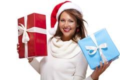 Vivacious woman in a Santa hat celebrating Xmas Royalty Free Stock Image
