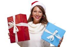 Vivacious woman in a Santa hat celebrating Xmas Royalty Free Stock Photos