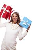 Vivacious woman in a Santa hat celebrating Xmas Stock Photos