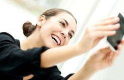 Vivacious woman taking her selfie Royalty Free Stock Photography