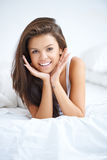 Vivacious young woman in bed Royalty Free Stock Photos