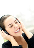 Vivacious young woman enjoying her music Royalty Free Stock Photos