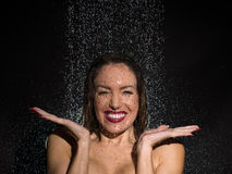 Vivacious young woman having fun in the shower Royalty Free Stock Photos