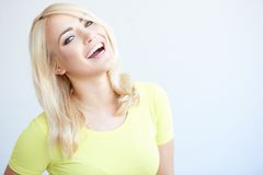 Vivacious young woman laughing at the camera royalty free stock image