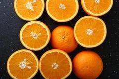 Vivd oranges slice on black slate Stock Photo
