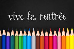 Vive la rentree (meaning Back to school) written on black chalkboard background Royalty Free Stock Images