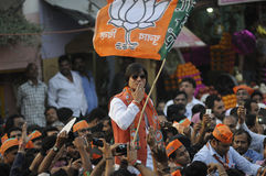 Vivek Oberoi in Varanasi. VARANASI - MAY 6: Bollywood actor Vivek Oberoi giving a flting kiss to his supporters while campaigning for Narendra Modi during a stock images
