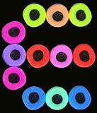 Vivid. Twelve vividly colored licorice allsorts sweets on a black background royalty free stock images