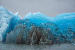 Vivid blue color of ice of a glacier royalty free stock image