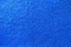 Vivid blue handmade knit fabric from above. Vivid blue hand made knit fabric from above Royalty Free Stock Photography