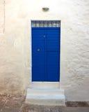Vivid blue house door Royalty Free Stock Photo